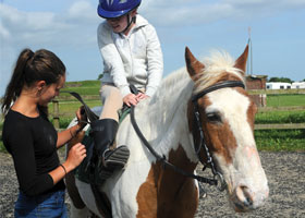 Girls and teacher horse riding lesson, Independent School Portsmouth