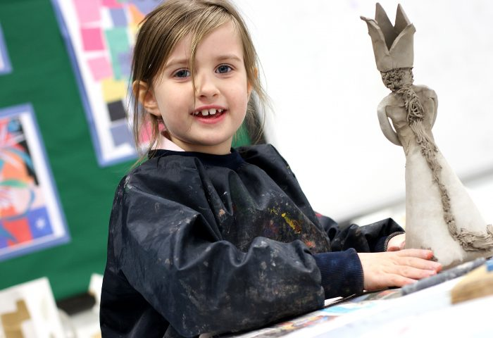 Prep School girl making a queen model in ceramics, Independent School Portsmouth