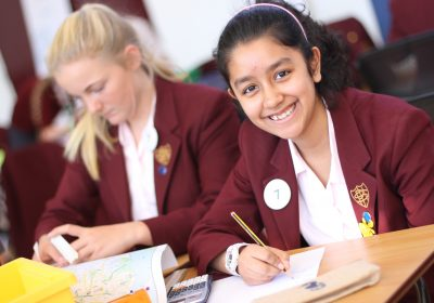 Independent School Portsmouth, Girls sitting at a desk writing