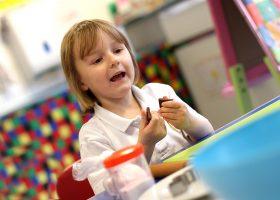Nursery School practising counting chocolate squares