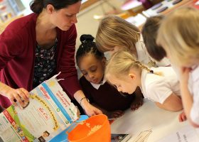 Nursery School finding out how to use scales to weigh