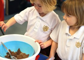Nursery School finding out how chocolate melts