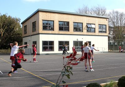 Modern classroom at Private School Portsmouth with girls playing outside