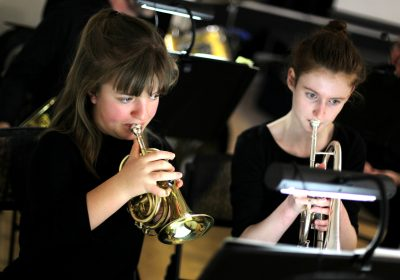 Independent School Portsmouth, two senior girls playing instruments, performing in a concert