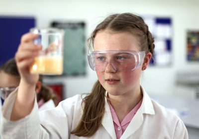 Independent school, Portsmouth High School, girl holding beaker in science