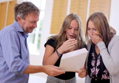 Private School Portsmouth, Student celebrating outstanding GCSE results with her parents