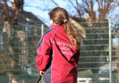Independent School Portsmouth close up of girls back on hockey astroturf