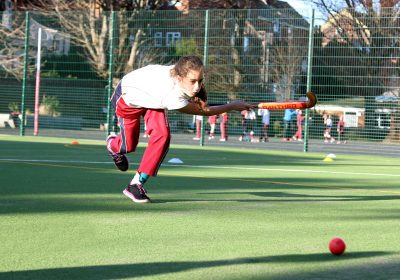 Girl playing hockey on astroturf, Private School Portsmouth