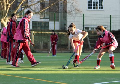 Girls playing hockey on astroturf, Private School Portsmouth