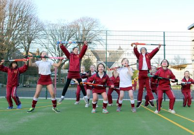 Girls Jumping up celebrating on astroturf at Independent School Portsmouth
