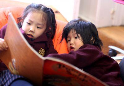 Reception Class children sharing a book