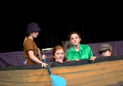 Peter Pan cast in boat on stage