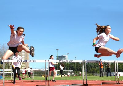 Jumping over hurdles at Portsmouth High School's sports day