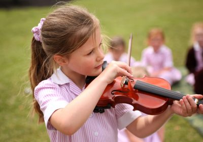 Violin player in Reception Class at Portsmouth High School