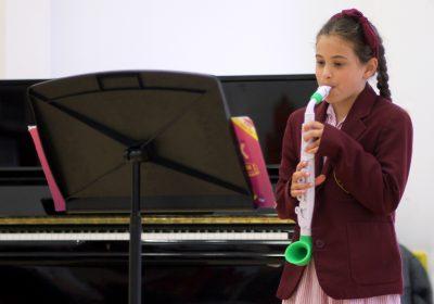 Prep School girl playing saxophone