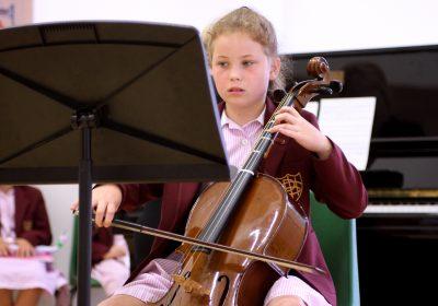 Prep School girl playing cello