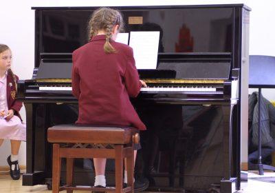 Prep School girl playing piano