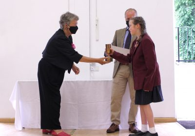 Young musician being awarded cup